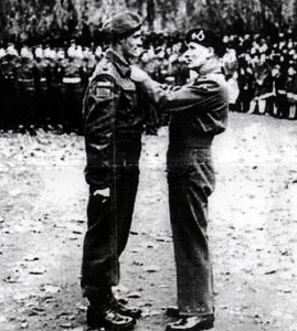 Major Charles Dalton receiving the DSO from General Montgomery