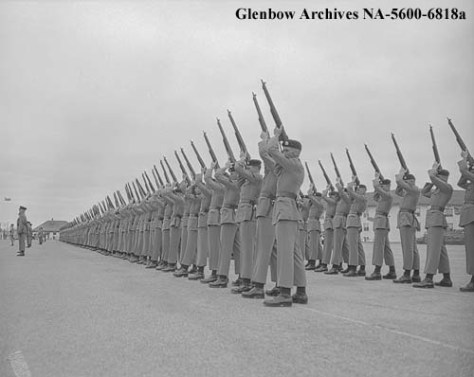 1st Battalion fires feu de joie on Victoria Day 1957 at Currie Barracks, Calgary, Alberta [Photo courtesy of Glenbow Museum NA-5600-6818a]