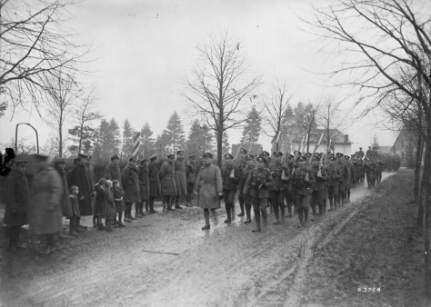 3rd Canadian Infantry Battalion passing the Border into German territory, 4th December, 1918, on way to Rhine. [Petit Thier]. Credit: Canada. Dept. of National Defence/Library and Archives Canada. PA-003641