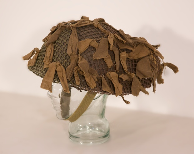 "British made Mk III ""Turtle shell"" Helmet with Canadian helmet net, scrim and Dressing"