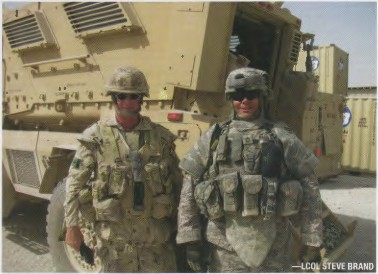 "The new ""light"" infantry in the GWOT: LCol Brand (L) and American colleage SFC Haag in front of an MRAP (Mine Resistant Ambush Protected) vehicle after a Combat Logistics Patrol to Tarin Kowt, July 2009. The full Canadian PPE (Personal Protection Equipment) and weapon can weigh close to 50 lbs (without rucksack)."