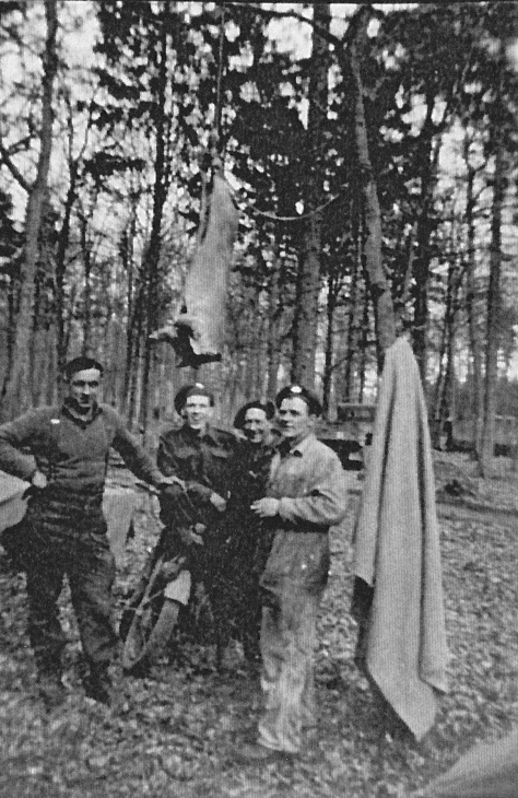 Rfn in woods posing under a pig La Capell France 11 Sept 1944
