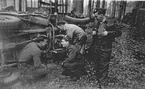 Working on a jeep La Capell France 11 Sept 1944