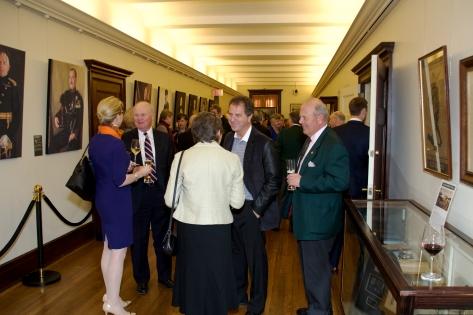 Guests mingle at the QOR Portraits Exhibit launch reception.