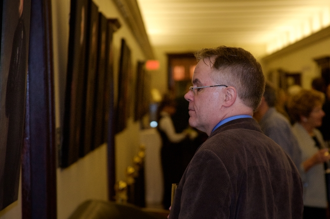 Ontario Assistant Deputy Minister for Culture, Kevin Finnerty studies the portraits at the Regimental Museum's exhibit launch reception on 21 April 2015.