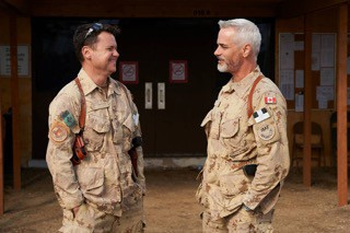 Ted Howard (L) and Paul Gross on the set of Hyena Road.